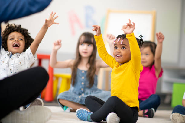 Multi-ethnic group of preschool students in class stock photo