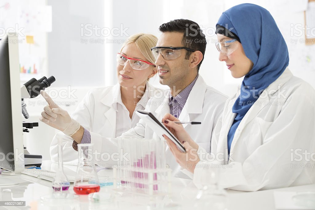 Multi-Ethnic group of scientists working in a lab. stock photo