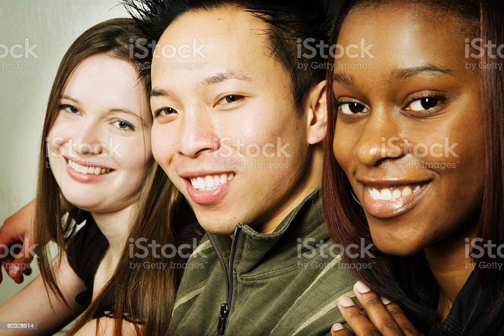 Multi-ethnic group of smiling young adults royalty-free stock photo