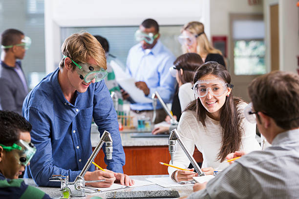 Multi-ethnic group of students in chemistry class stock photo