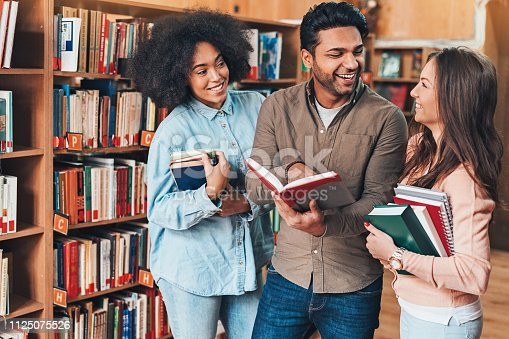 istock Multi-ethnic group of students in the library 1125075526