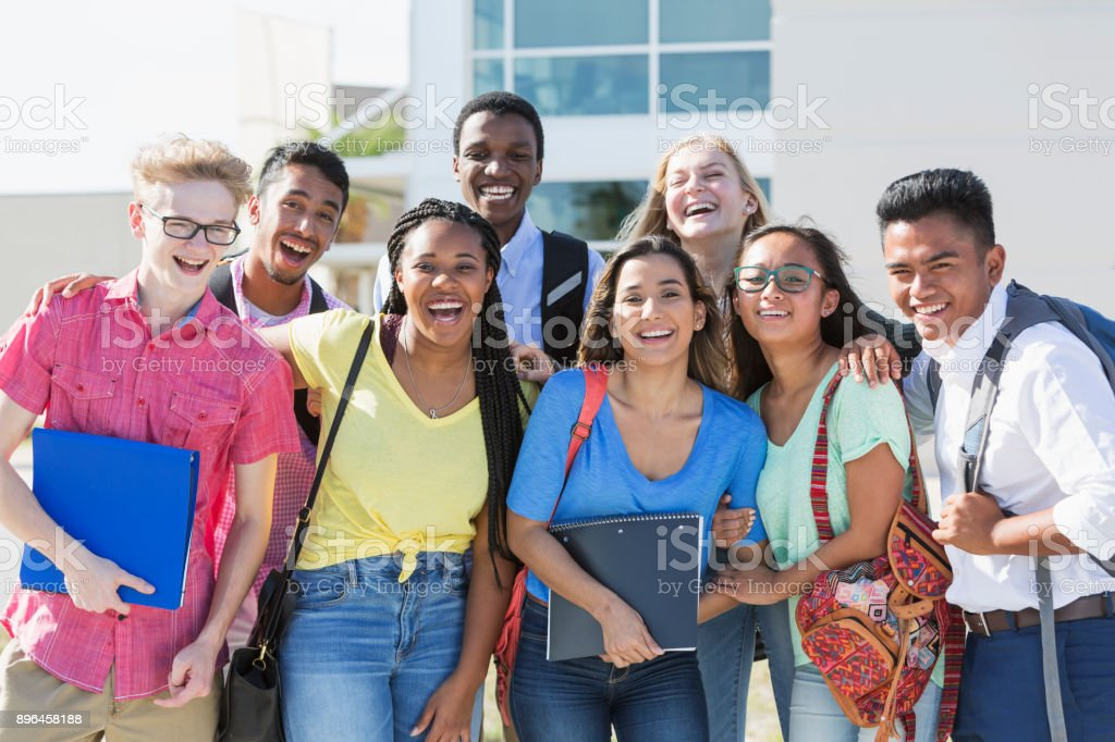 Multi-ethnic group of teenagers at school, outdoors stock photo