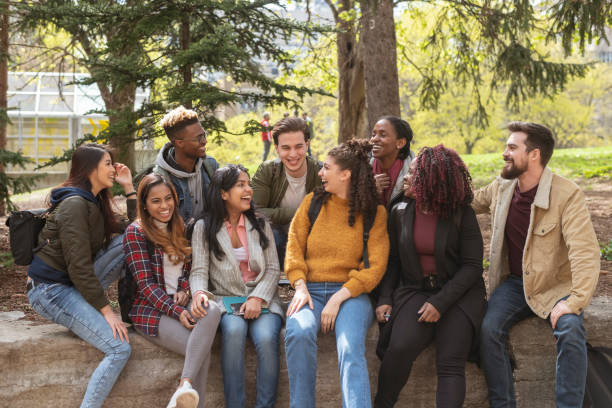 Multi-Ethnic Group of University Students Playing stock photo