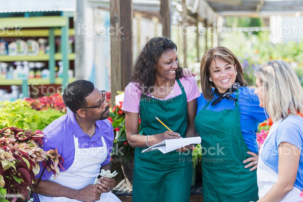 Multi-ethnic group of workers in garden center stock photo