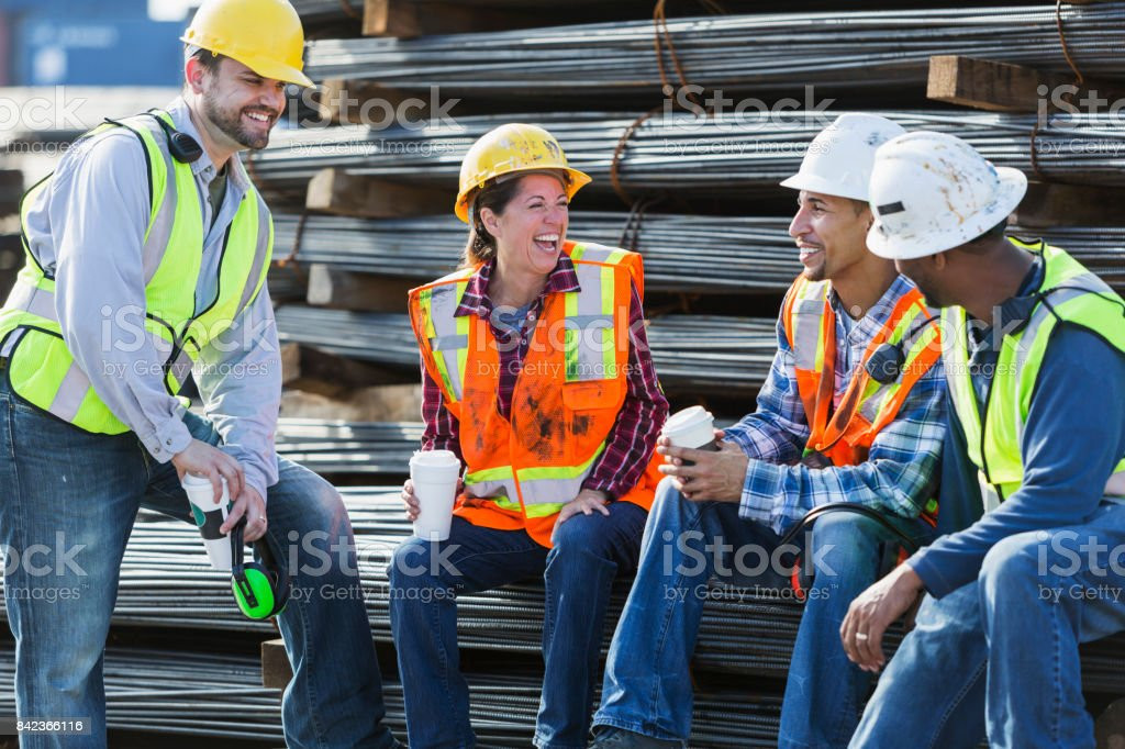 Multi-ethnic group of workers taking coffee break stock photo