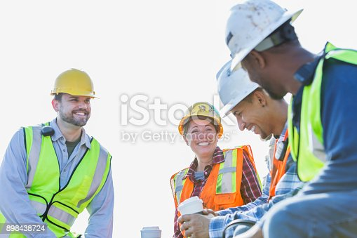 istock Multi-ethnic group of workers taking coffee break 898438724