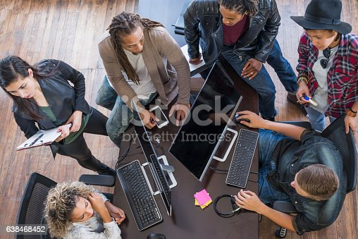 istock Multi-ethnic group of young creatives brainstorming 638468452