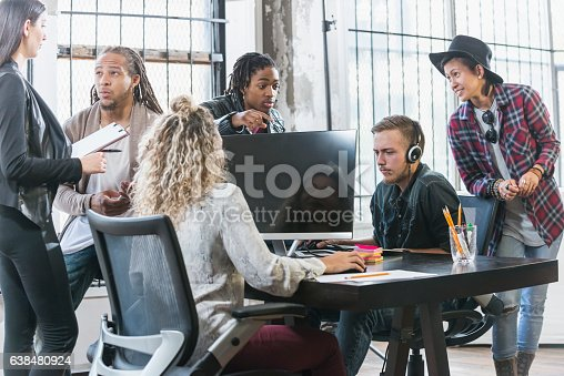 istock Multi-ethnic group of young creatives brainstorming 638480924