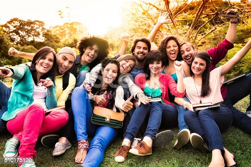 istock Multi-ethnic group of young students having fun at university campus 510175120