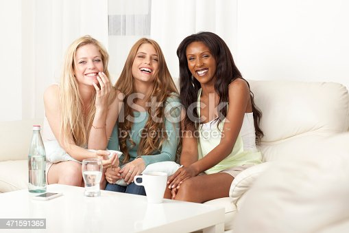 700702502istockphoto Multiethnic group of young women communicate at guest room. 471591365
