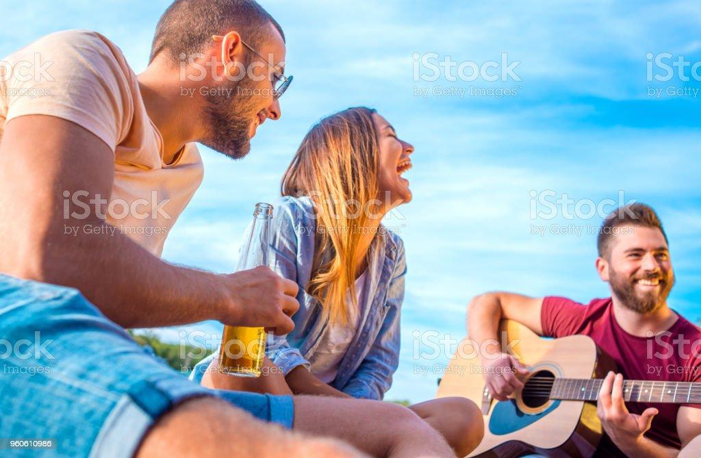 Multi-Ethnic Group Play Guitar stock photo