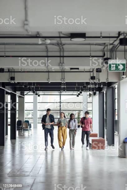 Multiethnic group university students walking in hallway picture id1212648489?b=1&k=6&m=1212648489&s=612x612&h=jh6kefmfp81oyzwdzaz7nat6sirwpsmegp1tljty6am=