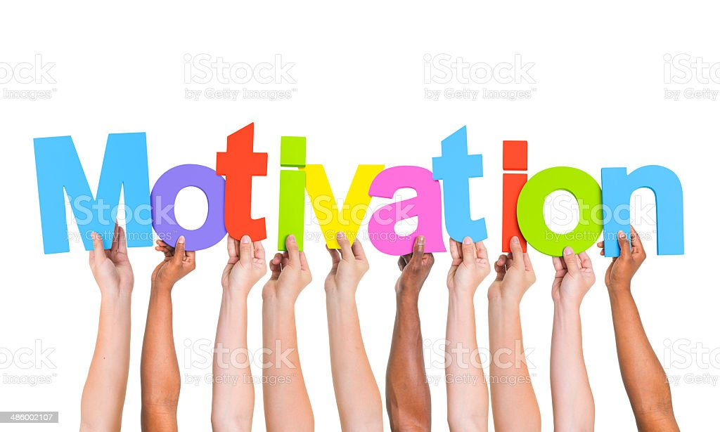 Multi-Ethnic Hands Holding Colorful Letters To Form Motivation stock photo