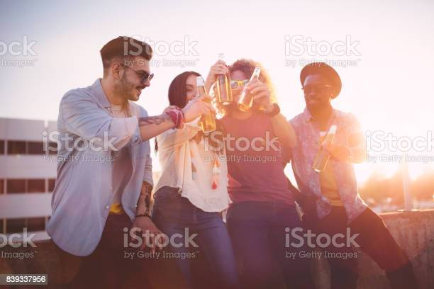 Multiethnic hipster friends toasting with beer at rooftop party picture id839337956?b=1&k=6&m=839337956&s=612x612&h=ccx6 f cdfkntedxc jhzwuzrfvjjfyofnfjkf7okti=