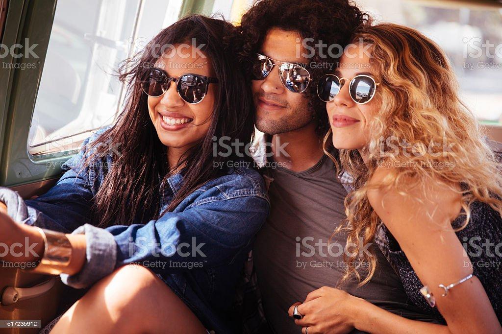 Multi-Ethnic Hipster Group in Retro Van Taking Road trip Selfie stock photo