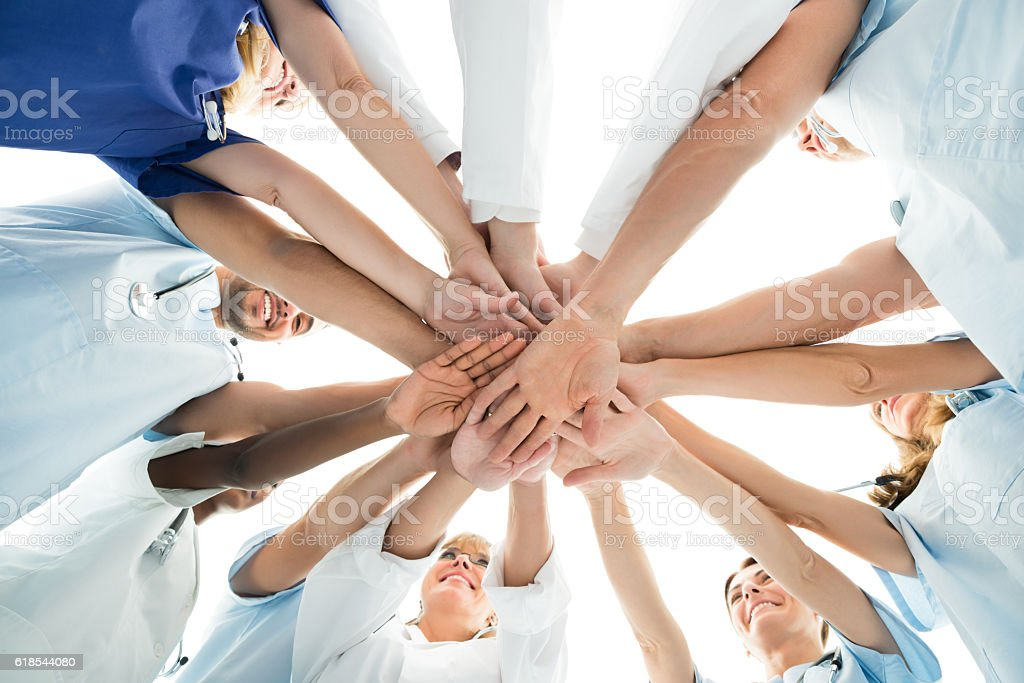 Multiethnic Medical Team Stacking Hands stock photo