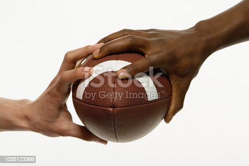 Multi-ethnic men holding football