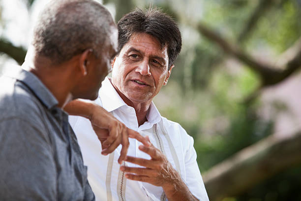 multi-ethnic men talking - indian man stock photos and pictures
