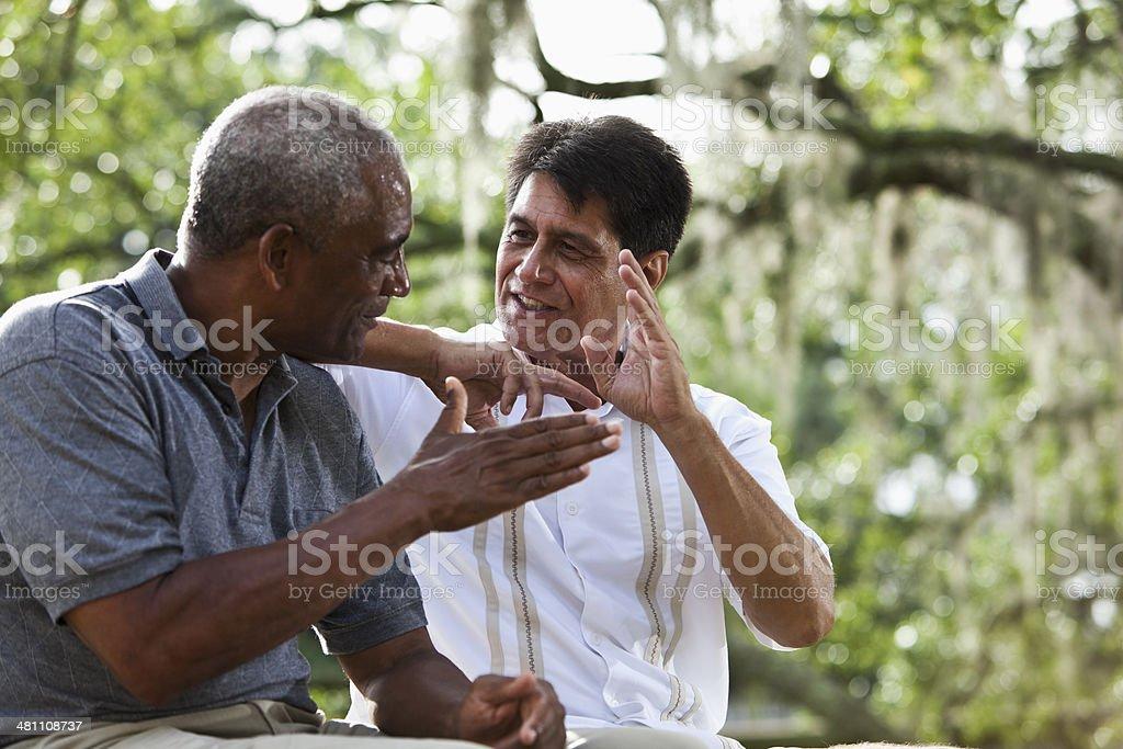 Multi-ethnic men talking stock photo