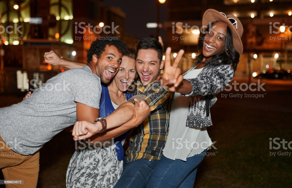 Multi-ethnic millenial group of friends taking a selfie photo royalty-free stock photo