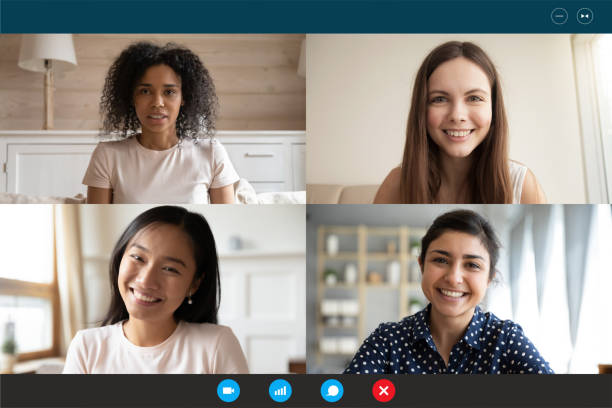 Multiethnic millennial girls using video call application webcam screen view Head shot portrait four multiethnic millennial girls using video call application laptop webcam screen full frame view. Distant chat, virtual communication, modern technology, webinar activity concept young girls on webcam stock pictures, royalty-free photos & images