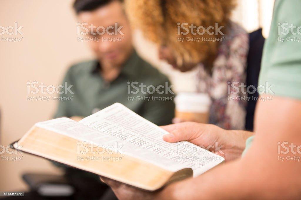 Multi-ethnic, mixed age bible study group. stock photo