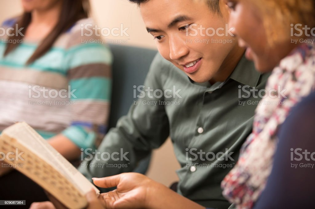 Multi-ethnic, mixed age bible study group. stock photo