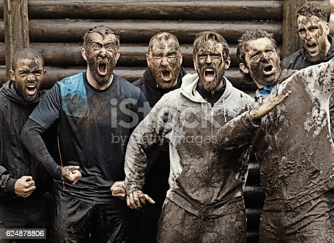 istock Multiethnic mud run team of men yelling during obstacle course 624878806