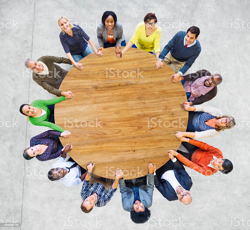 Multiethnic People Forming a Circle Holding Hands royalty-free stock photo