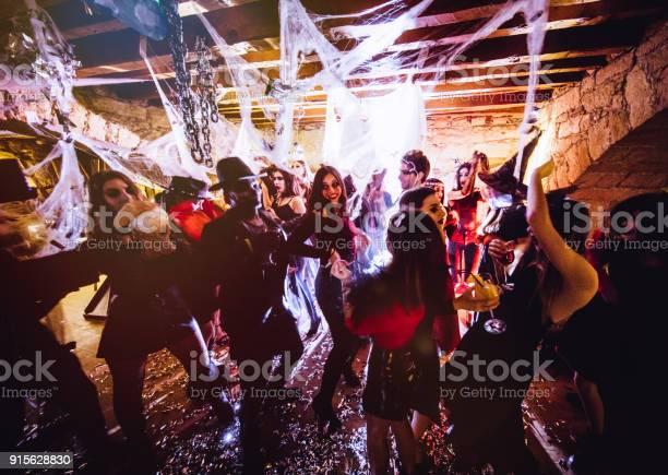 Multiethnic people in halloween costumes having fun at dungeon picture id915628830?b=1&k=6&m=915628830&s=612x612&h=pi1vbc7oyem1mmj 7bkjquciioceulwewcpwr0xbrti=