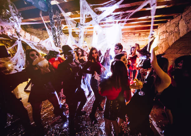 multi-ethnic people in halloween costumes having fun at dungeon nightclub - impreza zdjęcia i obrazy z banku zdjęć