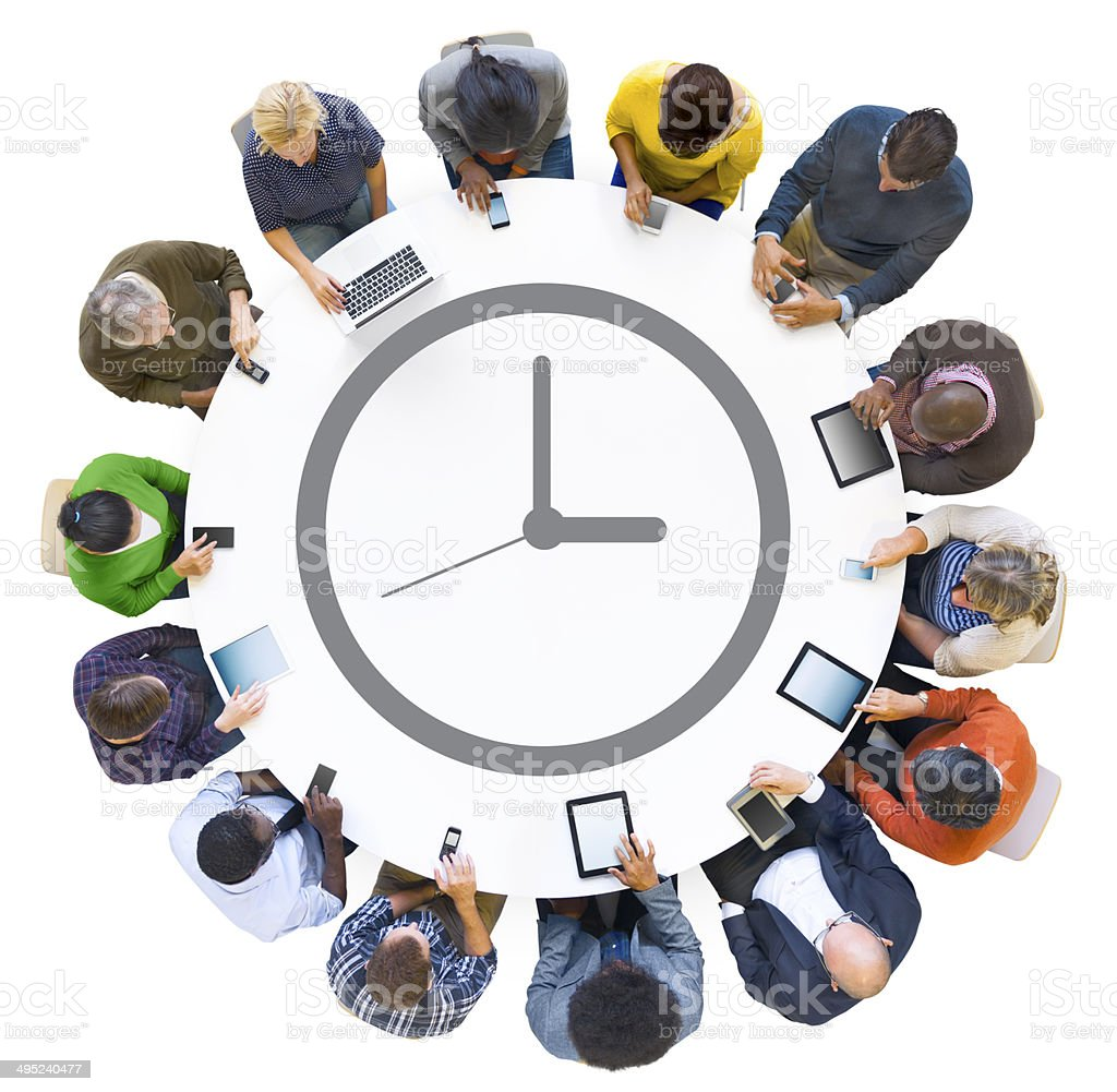 Multiethnic People Using Digital Devices with Clock Symbol stock photo