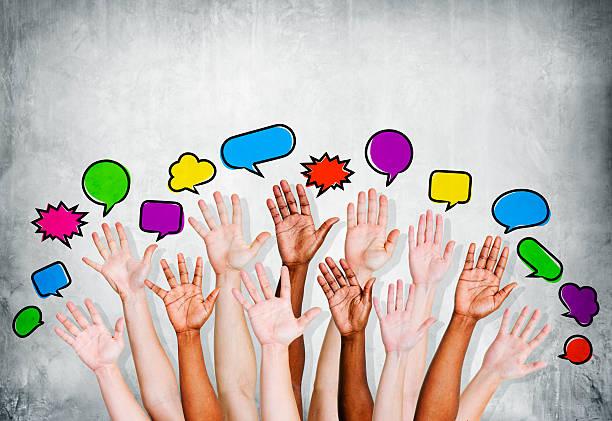 multiethnic людей с поднятые руки и выносная цитатная рамка - debate стоковые фото и изображения