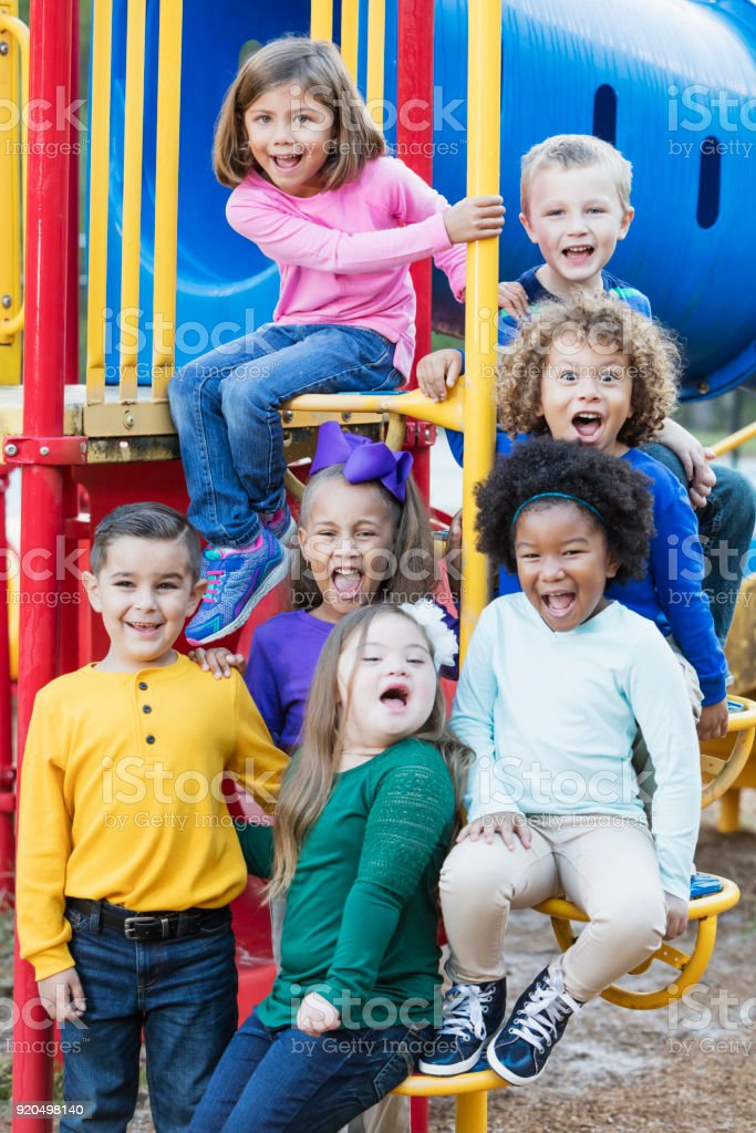 Multi-ethnic school children on playground stock photo