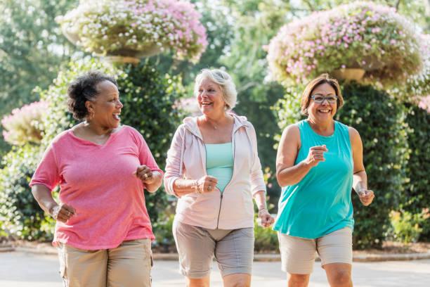 Multi-ethnic senior women exercising together stock photo