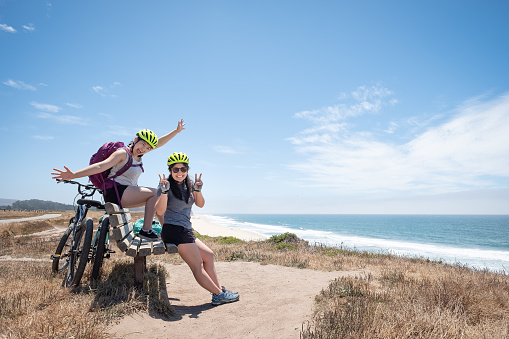 Multi-Ethnic Sisters with Bicycles Pose for Camera, California Coast