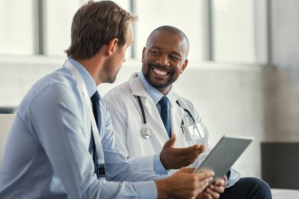 Multiethnic specialist doctors discussing case stock photo