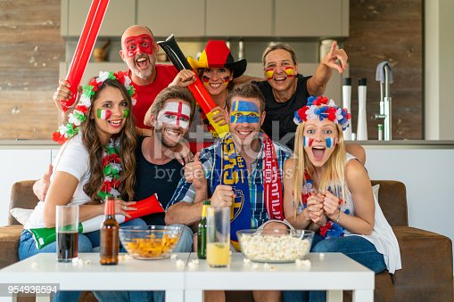 seven sports - soccer - fans from different nations cheering for their team in fan outfit