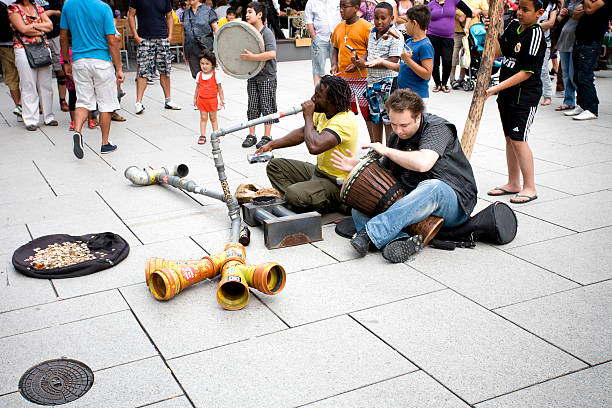 multi-ethnic street musicians - didgeridoo stock photos and pictures