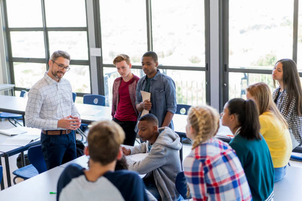 multi-ethnic students discussing with professor - teachers day stock photos and pictures