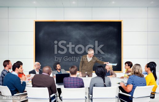 istock Multi-ethnic students gathered around professor 491522025
