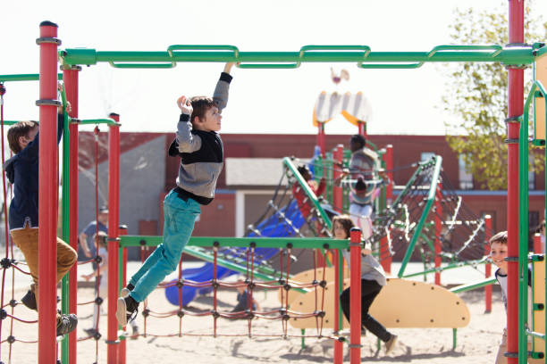 multi-ethnic students playing at schoolyard during the break time - recess stock pictures, royalty-free photos & images