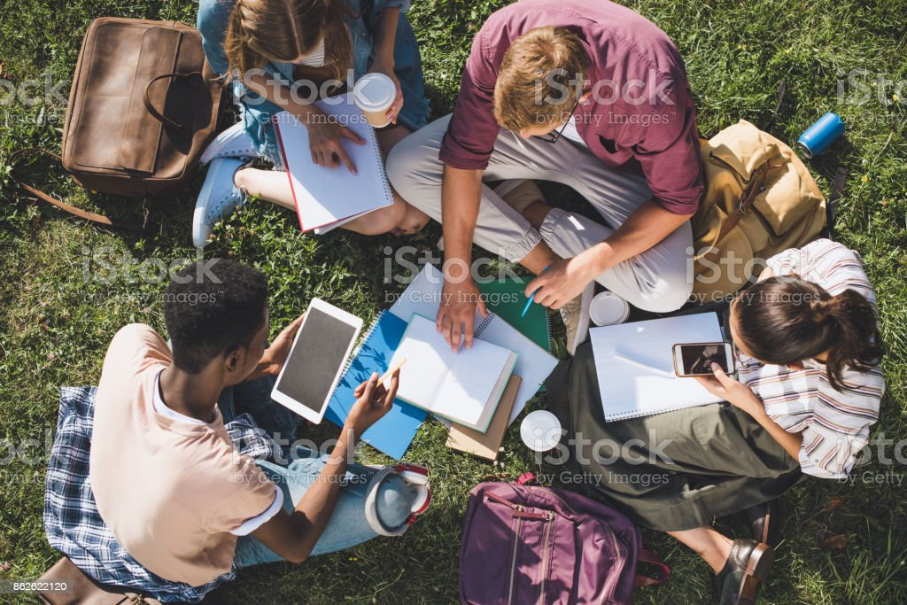 multiethnic students studying together stock photo
