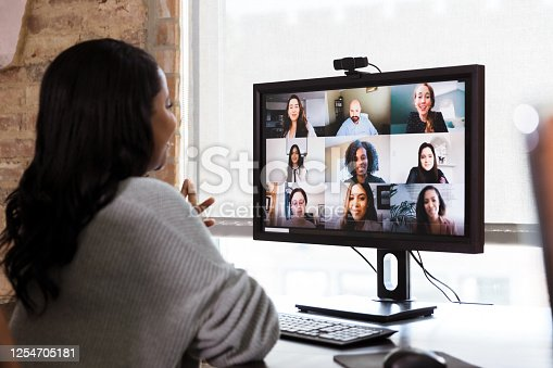istock Multi-ethnic team has meeting via video conference 1254705181