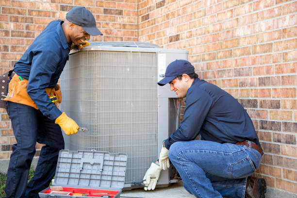 Multi-ethnic team of blue collar air conditioner repairmen at work. Multi-ethnic team of blue collar air conditioner repairmen at work.  They prepare to begin work by gathering appropriate tools from their tool box. technician stock pictures, royalty-free photos & images