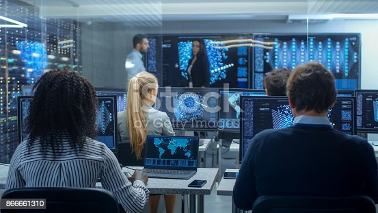 istock Multi-Ethnic Team of Research Engineers, Neural Network Architects, Programmists Working on a Machine Learning, Neural Network Building Project. Office Displays Show Working Model of Neural Network. 866661310