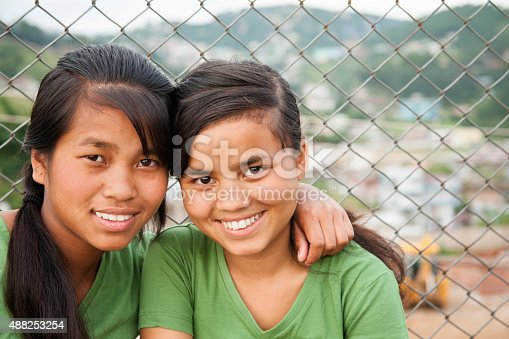 istock Multi-ethnic teenage girl friends posing outdoors. 488253254