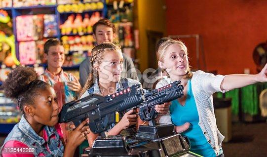 istock Multi-ethnic teenage girls in amusement arcade 1125442262