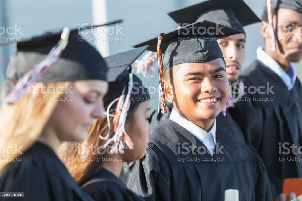 Multiethnic Teenage Graduates In Cap And Gown Stock Photo & More ...