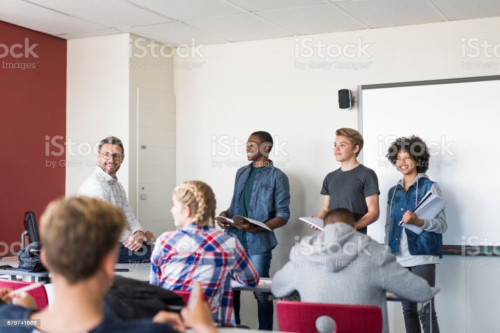 Multi-ethnic teenage students giving presentation stock photo
